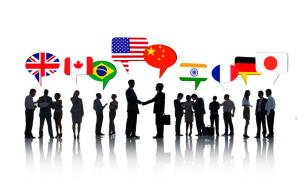 Group Of International Business People Talking To Each Other In